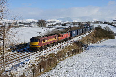 Tatty 90037 leads 90040 past Docker with Mossend-Daventry Malcolm containers, 2/2/19.