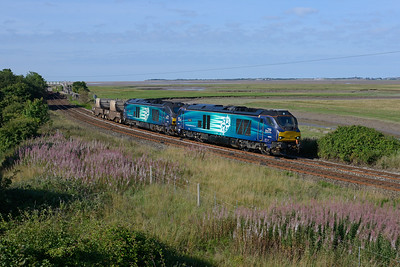 68003 + 68004 pass Kirkby in Furness with northbound flasks as the southbound train disappears in the distance, 11/8/18.