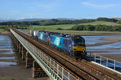 "88004 ""Pandora"" + 88002 ""Prometheus"" cross the Esk estuary with Sellafield-Crewe flasks on 9/8/18."