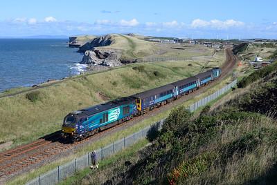 68017 leads the 0903 Carlisle-Barrow past Moss Bay on 9/8/18.