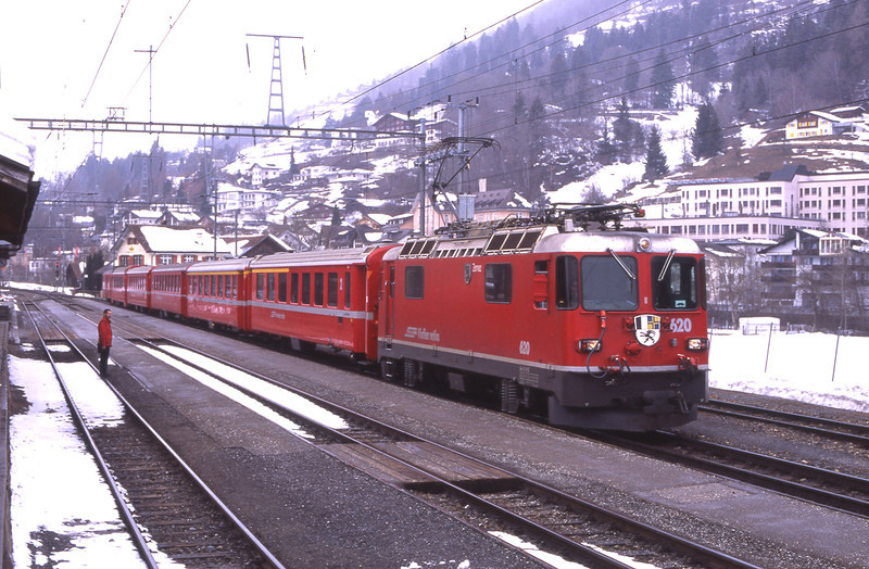 As the guard surveys the parish 620 stands waiting time at Ilanz with RE1237 09:44 Disentis/Mustér to Landquart service, 6/3/2012.