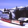 622 is seen near Cavadürli propelling 827 12:44 Klosters Dorf to Davos Platz schittelzug, 7/3/2012.