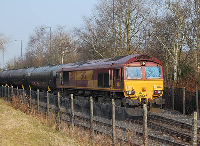 There is a regular freight flow of bitumen to the Total plant in Preston, which involves the use of exchange sidings near Strand Road. On 10th April 2013 the empty bitumen tanks were being returned to Lindsey Oil Refinery as the 6E32 behind 66186, seen here waiting for departure time (0905 according to the WTT)