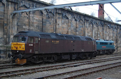 The locomotive waiting to move the two electrics was West Coast Rail 47245.