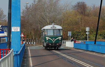 As E79960 is a bus, it might as well run along the road! Here it is, crossing the swing bridge on 10th April 2013.
