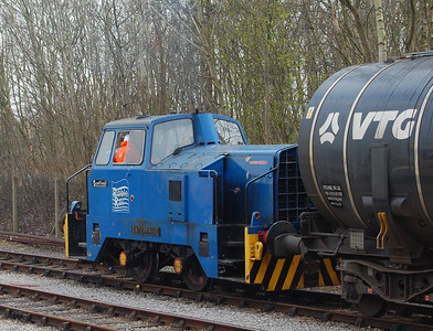 "A lunchtime break in the passenger service was necessary to facilitate shunting of the bitumen tanks. Fourteen tanks are delivered to the exchange sidings but the Total discharging point can only accommodate 7 tanks, necessitating some shunting. ""Enterprise"" is seen here moving 7 full tanks from the sidings at Preston Riverside."