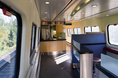 Inside the Acela Express Cafe Car.  Unlike the cafes on other Amtrak trains, this one doesn't have any booth-style seating -- just the small bar and stand-up area seen at rihgt.  The staff here were incredibly bored.