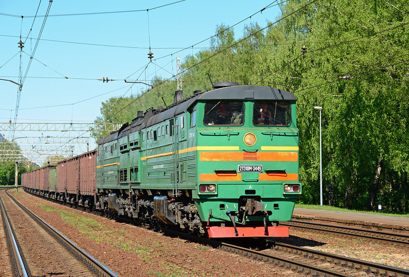 With a thumbs up from the train crew, 2T310M-3449 thunders through Tornakalns on the outskirts of Riga, with a fifty wagon coal train.<br /> These twin powered units a modernised version of a Soviet design are truly breathtaking, the sheer noise and vibration is something to savour !!