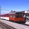 A red Rigi service from Vitznau arrives at Rigi Klum propelling one of the classic coaches, 31/7/2012.