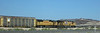 Head end of a unit auto rack train running strong alongside I-8 in southern Arizona.