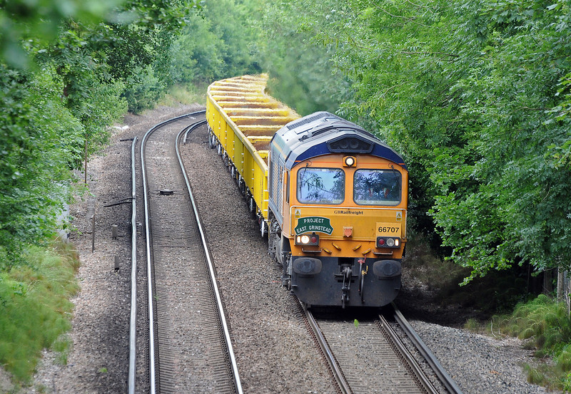 It was in July 2010 that GBRf started running the spoil trains to remove excavated material from Imberhorne cutting, the last obstacle preventing the Bluebell Railway reaching their Ultima Thule, East Grinstead. On July 7th, and sporting an appropriate headboard 66707 approaches East Grinstead with the second or third train of the series.