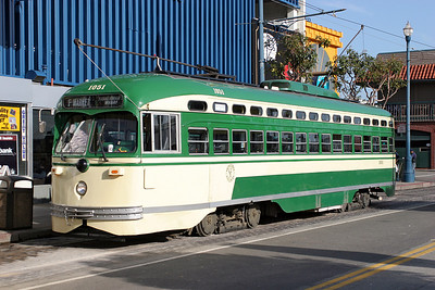 San Francisco F Line Streamliner PCC 1051 in San Francisco CA 1960's livery arriving at Beach & Jones on a service from Castro. 26/04/2007.