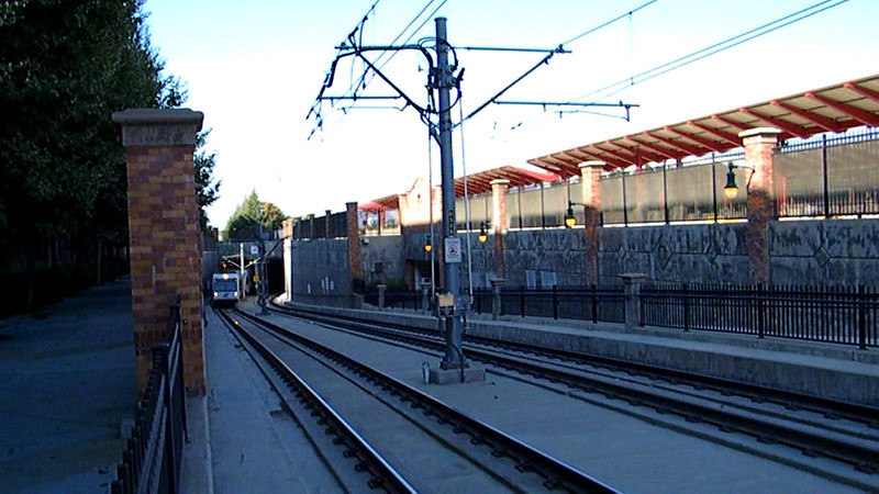 A Santa Clara Valley Transit Authority light rail train bound for Winchester emerges from its hole to stop at San Jose Diridon station on 9-14-11.
