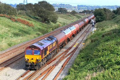 66181 passes Pilning with 6B33 13.35 Theale to Robeston empty tanks. 13/09/2011