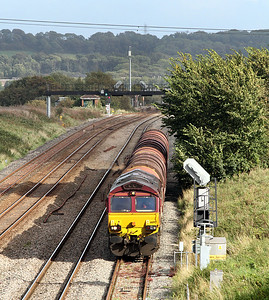 66192 waits the road in Pilning Loop with 6B50 14.45 Swindon Steel Terminal to Llanwern empty steel carriers. 13/09/2011