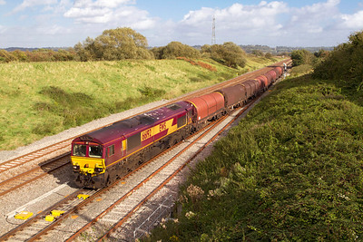 66192 departs from Pilning Loop with 6B50 14.45 Swindon Steel Terminal to Llanwern empty steel carriers. 13/09/2011