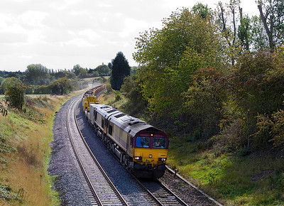 66109 with 66206 DIT passes Whitnash with the 6M50 07.36 Westbury Yard to Bescot Yard engineers service. 21/09/2011