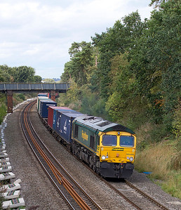 66569 heads through the cutting at Kings Sutton with 4O09 10.18 Trafford Park to Southampton Freightliner. 21/09/2011