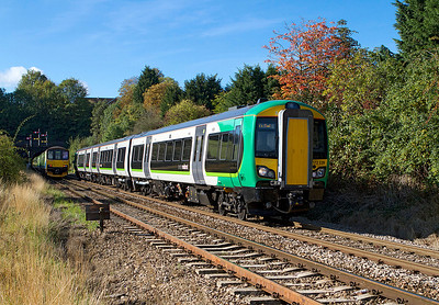 172339 heads away from from Shrub Hill and passes a Class 150 waiting to enter Rainbow Hill Tunnel on a service to Worcester Foregate Street. 21/09/2011