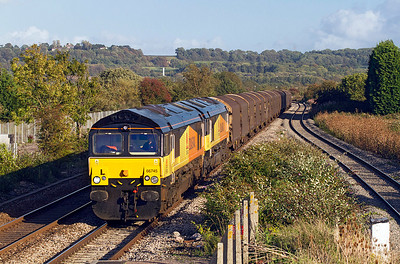 66745 with 66742 DIT passes Pilning Station with 6Z78 11.46 Dollands Moor to Llanwern steel carriers, Tuesday 13th September 2011.