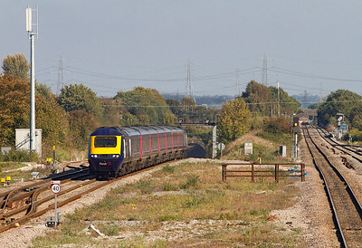 The 13.15 Paddington to Cardiff Central climbs out of the Severn Tunnel and passes Severn Tunnel Junction with power cars 43140 and 43012 providing the traction. 28/09/2011. Note how the roof of the tunnel tapers down giving the effect of a second portal.