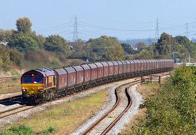 66151 approaches Severn Tunnel Junction on the Chepstow line with 6V67 03.53 Redcar to Margam consisting of 31 HTA's loaded with coke. Caldicot Station can be seen at the back of the train. 28/09/2011