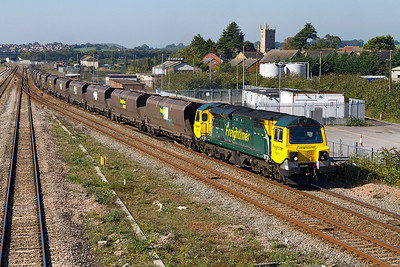 70011 heads the 4F56 10.42 Uskmouth Power Station to Stoke Gifford Yard empty coal hoppers past Severn Tunnel Junction. 28/09/2011