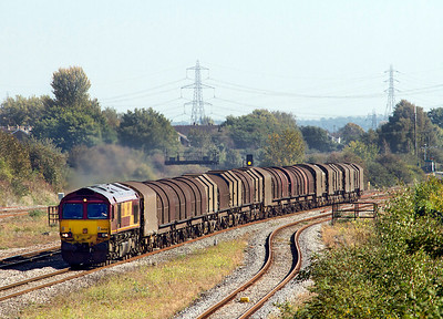 66066 powers past Severn Tunnel Junction heading 6V05 09.25 Round Oak to Margam empty steel carriers. 28/09/2011