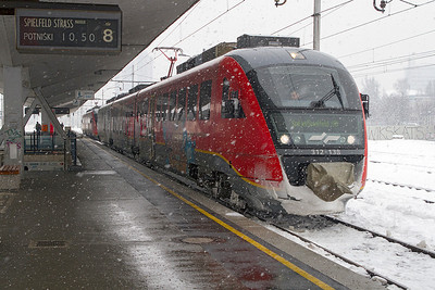3 car Siemens Desiro EMU 312-138 departs from Ljubljana at 10.50 to Spielfeld Strass. Wednesday 13th February 2013.