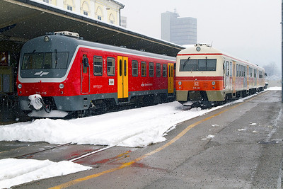 A pair of Class 715 2 car DMU's showing a difference in liveries at Ljubljana. Wednesday 13th February 2013.