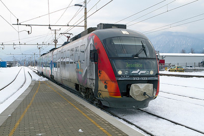 3 car Siemens Desiro 3 car EMU 312-123 arrives at Lesce-Bled forming the LP2406 13.32 Ljubljana to Jesenice. Thursday 14th February 2013.
