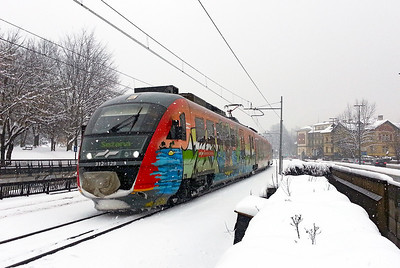 3 car Siemens Desiro 3 car EMU 312-123 arrives at Ljubljana Tivoli on a Ljubljana to Sezana service. Wednesday 13th February 2013.