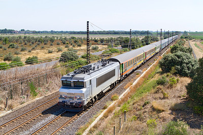 22272 heads Train 4757 10.15 Marseille St Charles to Bordeaux St Jean past Bezeirs Airport. Sunday 18th August 2013.
