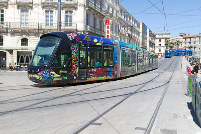 Montpellier Alstom Citadis tram No. 2088 working a Line 3 service takes the junction outside the main railway station as a line 1 service follows behind. Monday 12th August 2013.