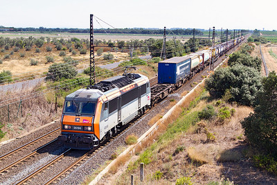 Sybic 26196 heads past Beziers Airport with a westbound Intermodal service consisting mainly of tanktainers. Sunday 18th August 2013.