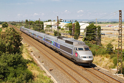 TGV 49 forming service 6887 08.47 Bordeaux to Marseille St Charles passes Bezeirs Airport. Sunday 18th August 2013.