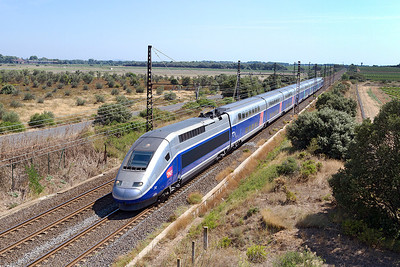TGV Duplex 212 forming 6205 08.07 Paris Gare de Lyon to Beziers nears the end of its journey passing Beziers Airport. Sunday 18th August 2013.