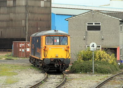 GBRF Class 73 No. 73209 is the standby loco for the operation and is seen stabled at the side of the weighbridge at Tremorfa Works.