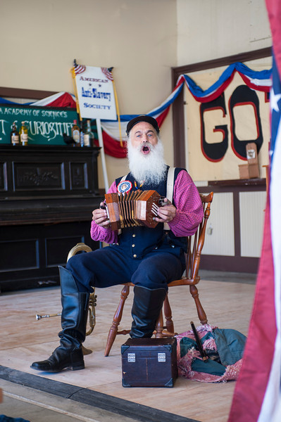 "Dressed in 1860's garb, this man regaled the audience with songs by Stephen C. Foster (although I was disappointed that he didn't sing ""Camptown Races""), and showed his prowess with the concertina and various fifes."