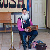 """Dressed in 1860's garb, this man regaled the audience with songs by Stephen C. Foster (although I was disappointed that he didn't sing """"Camptown Races""""), and showed his prowess with the concertina and various fifes."""