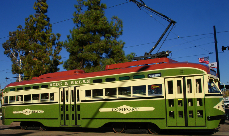 San Diego's vintage PCC streetcar, No. 529, approaches the transit plaza at 12th & Imperial.  Note original trolley retained on roof at left, a stark contrast with huge and ungainly pantograph required to operate 529 over San Diego's modern light rail system.  Photo by Alice.