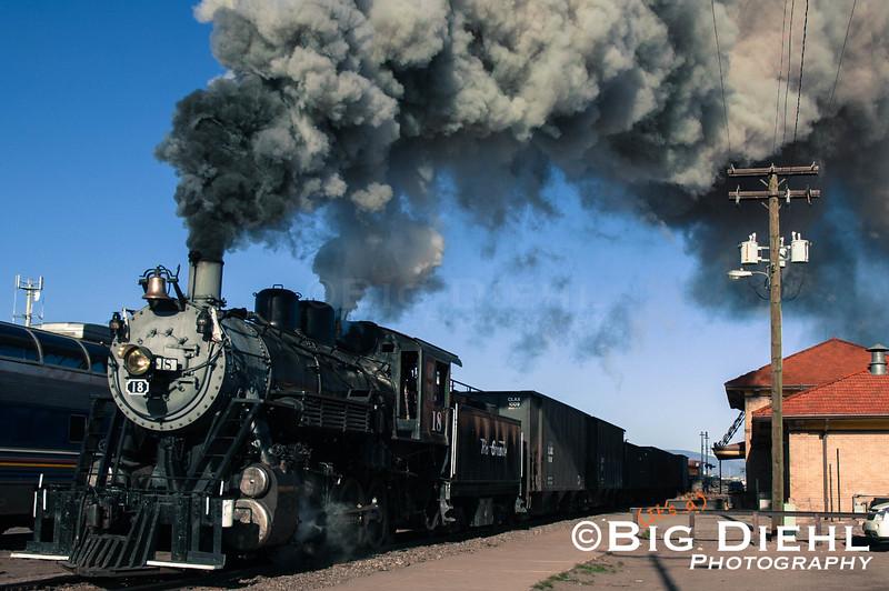 """SLRG 18 East""<br /> <br /> The 18 highballs out of the Alamosa Depot eastward towards La Veta."