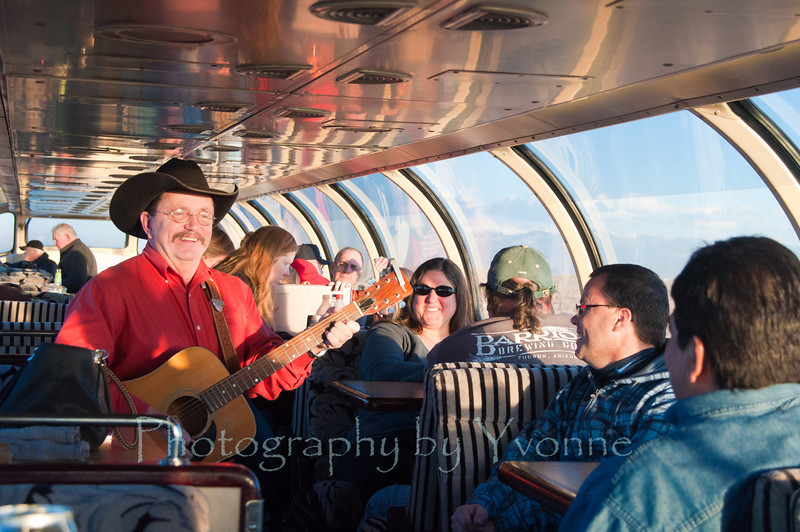 Fred Hargrove entertains passengers in the dome car.