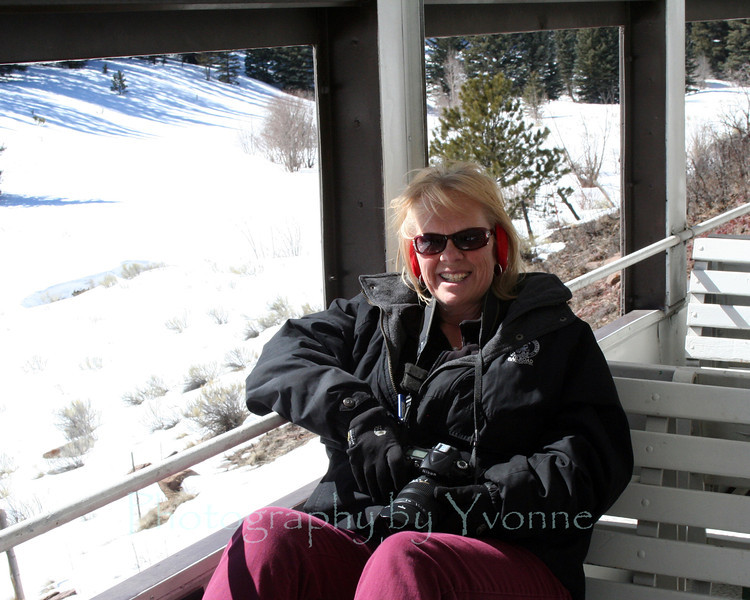 Yvonne riding the rails in the open car.