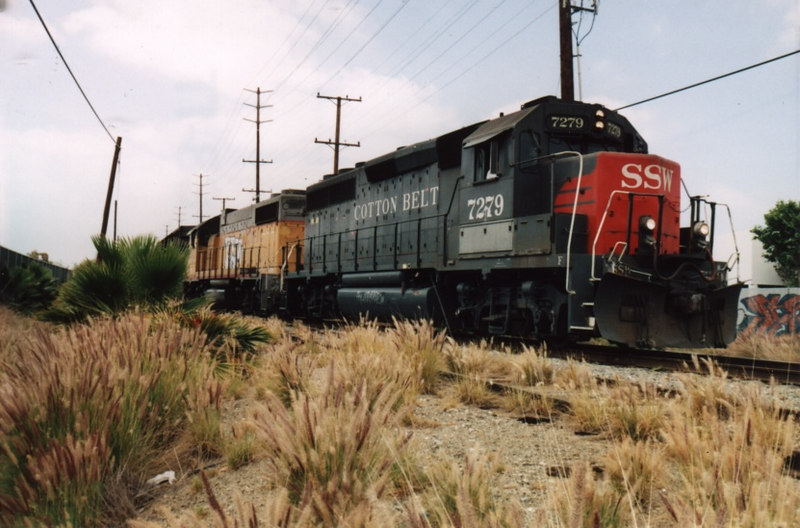 Kneeling in the tall weeds got me this shot of an unblemished Cotton Belt unit approaching the Cerritos Ave. crossing.