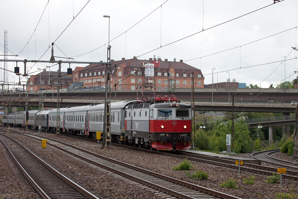 Rc6 1329 with passenger train headed for Stockholm in Karlberg.