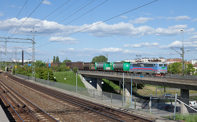 Rc6 with a container train on the yard lead into Vastberga in Arstaberg.
