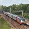 "Hector 242.531 ""La Motta"" leads the Veolia train Stockholm-C Malmö through Flemingsberg."