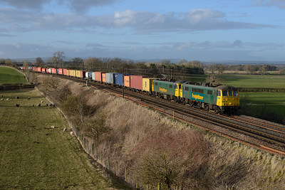 86610+86639 head the Coatbridge-Crewe liner near Gretna 10/3/15.