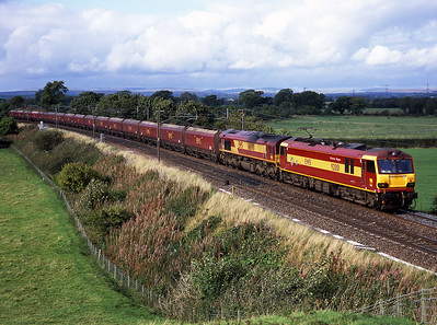 In September 2005 EWS trialled class 92s on coal trains over Beattock; 92001 with 66090 inside pass Springfield on 20/9/05.